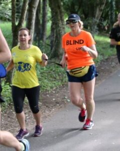 Jane running with a guide