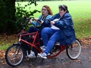 Sharon (on the left) and Julie (on the right) on a side by side bike