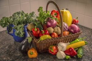 A basket of colourful fruits and vegetables